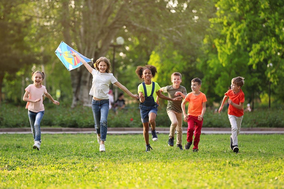Kids running with kite