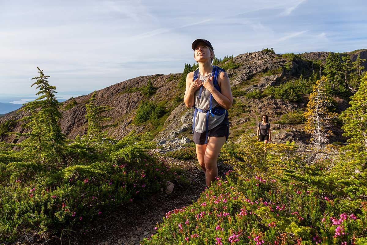 women walking through wildflowers
