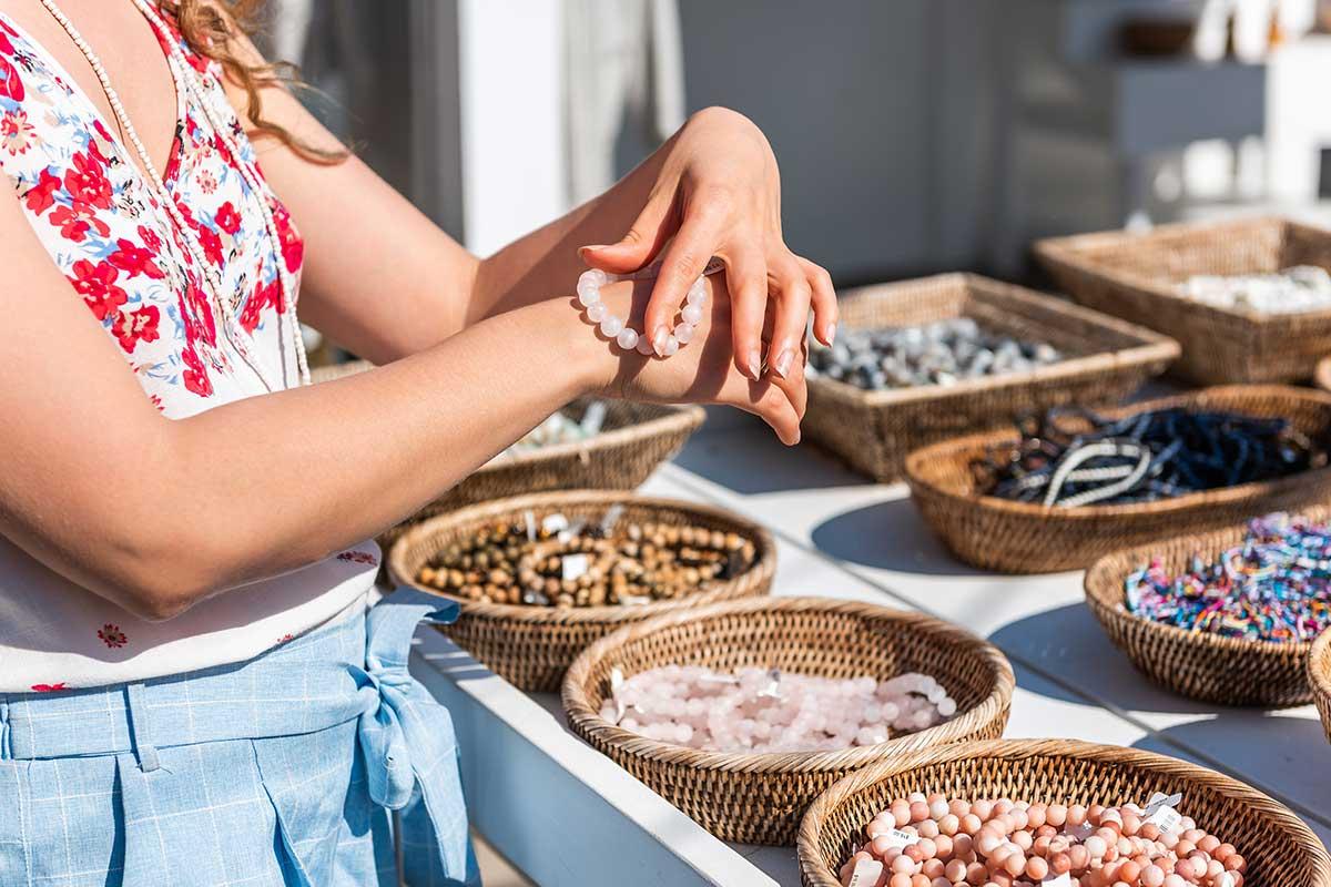 girl holding jewelry